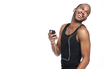 smiling man with headphones and turning around