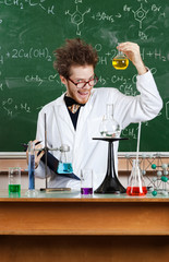 Mad professor shows flat-bottomed flask in his laboratory