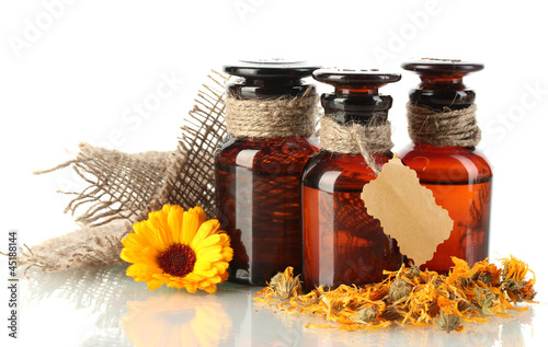 medicine bottles and calendula, isolated on white