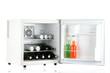 Mini fridge full of bottles of alcoholic beverages isolated