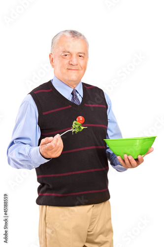 Mature gentleman eating a salad