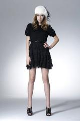 full body young fashion model posing light background