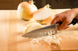 Cook chopping onions with knife