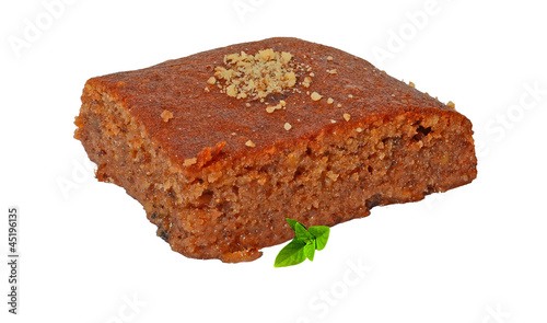 pecan pie with grated walnuts and syrup and basil leaves