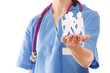 A female doctor holding paper people, focus on the hand