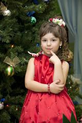 child under a fur-tree
