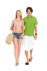 Attractive young couple in beach clothing, going on vacation