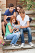 Group of Teenage Friends with Tablet PC