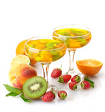 punch in glasses with fruits, isolated on white