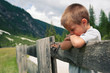 Portrait of four year old boy outdoors in the mountains.