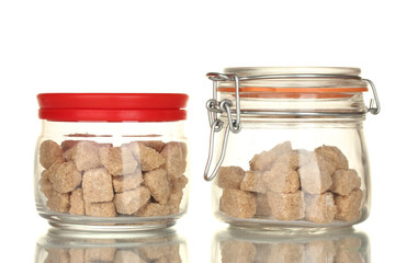 Jar and sugar-bowl with brown cane sugar lump isolated