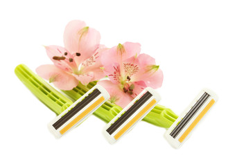 woman safety shavers and flowers isolated on white.