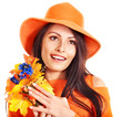 Happy woman wearing orange hat with flower.