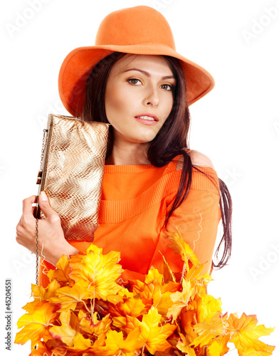 Woman holding  orange leaf and handbag.