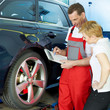 Car mechanic and customer look at the repair costs