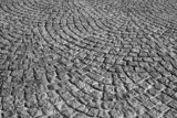 Black and white cobbled roadway texture