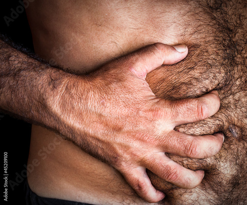 Man suffering from severe abdominal pain