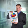 Business Man Holding Graph Chart