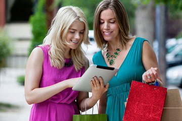 Shopping Women Using Digital Tablet