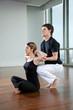 Yoga Instructor Assisting Woman