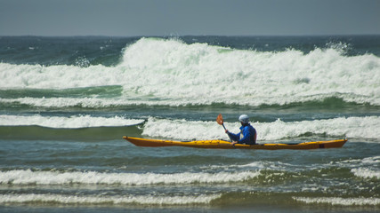 Kayaker in Surf at Cannon Beach Oregon