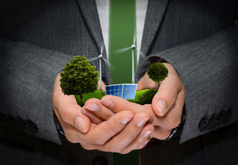 Hands hold Green Energy