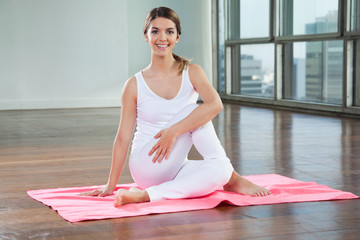 Happy Woman Practicing On Yoga Mat