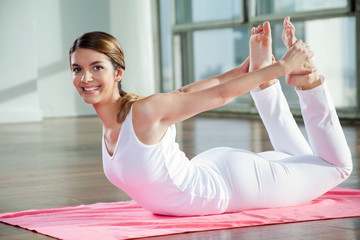 Happy Woman Practicing Yoga