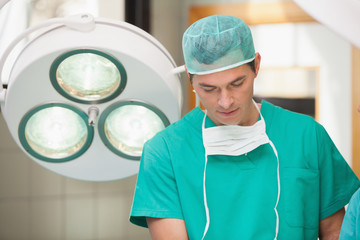 Surgeon standing in an operating room