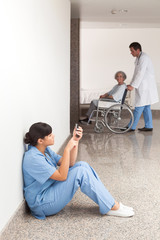 Nurse looking at her mobile phone