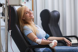 Smiling woman donating blood