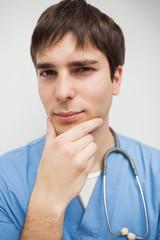Nurse looking at the camera thinking