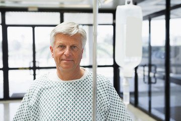 Patient standing in the corridor with IV drip
