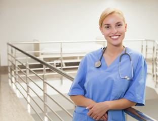 Smiling nurse standing in a stairwell