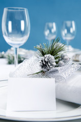 Blue silver christmas table setting with glasses and copy space
