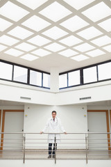 Doctor standing in stairwell