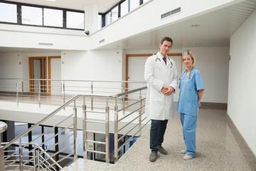Nurse and doctor standing in hallway