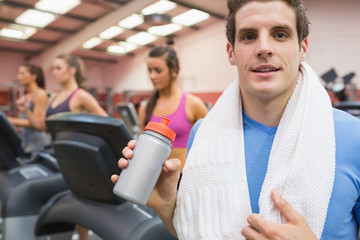 Man drinking in gym