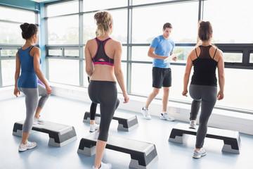 Trainer teaching his aerobic class
