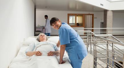 Nurse smiling next to an elderly lady