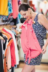 Woman looking at shirt in