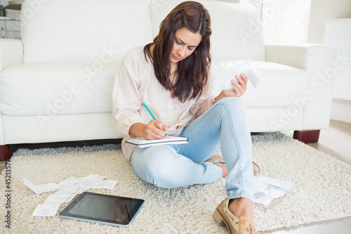 Young woman adding receipts