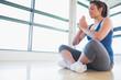 Women meditating in sitting yoga pose