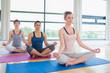 Women meditating in easy yoga pose