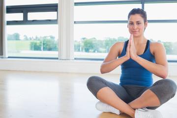 Woman sitting on the floor legs crossed
