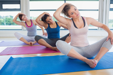 Women stretching in bound angle yoga pose