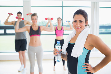 Woman at front of aerobics class