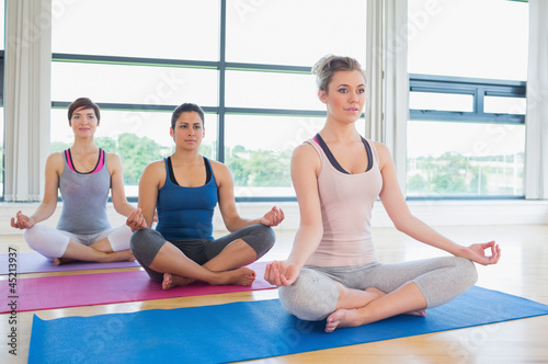 Women meditating in easy yoga pose
