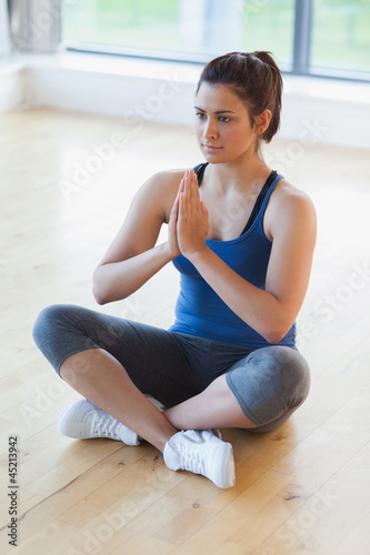Woman sitting in easy yoga pose