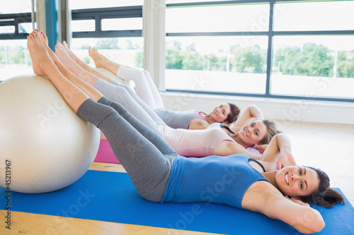 Happy women about to do sit ups
